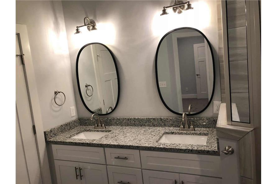 Very attractive master bathroom with dual vanities