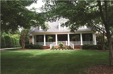 Photo of this Southern country home with wide porch. (ThePlanCollection: House Plan #180-1024)