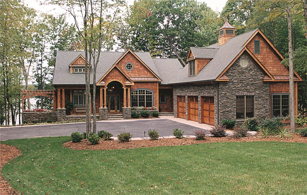 Front elevation of Craftsman home (ThePlanCollection: House Plan #180-1047)