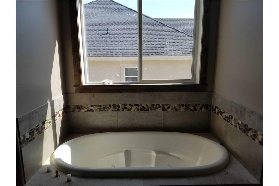 Master Bathroom: Tub of this 1-Bedroom,2428 Sq Ft Plan -2428