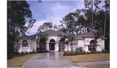 Front elevation photo of this Mediterranean home (ThePlanCollection: House Plan #190-1000)