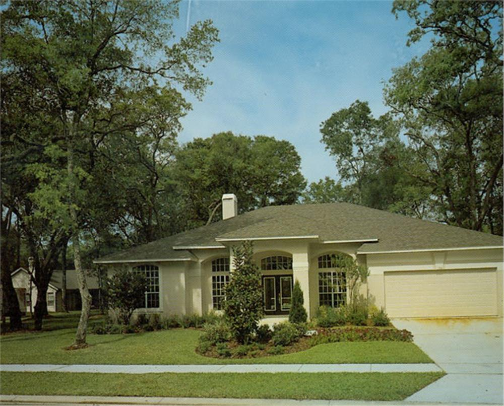 Front elevation photo of this Mediterranean ranch home (ThePlanCollection: House Plan #190-1005)