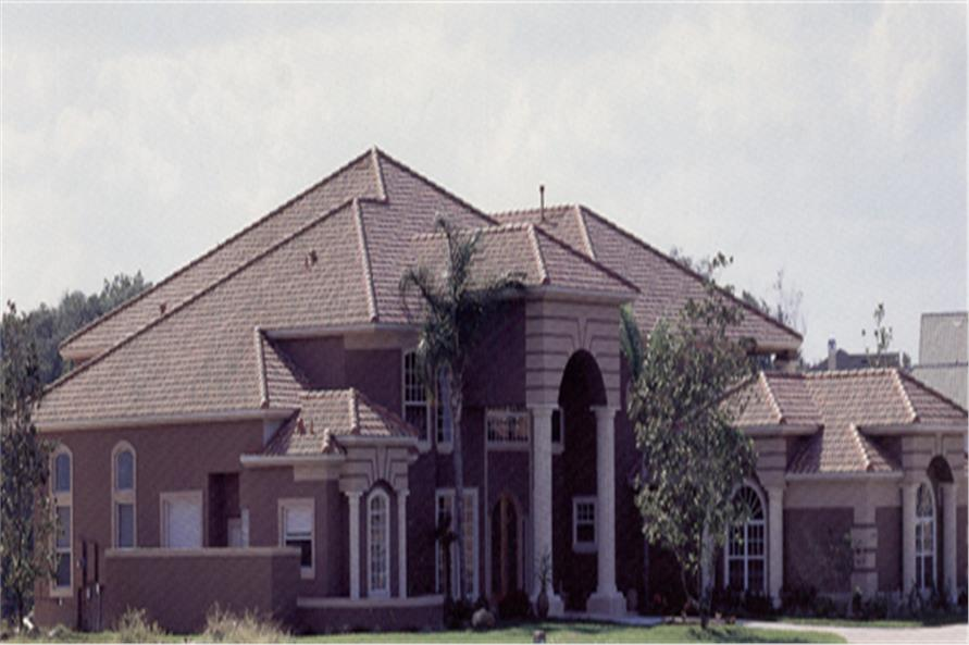 Front elevation photo of European style home (ThePlanCollection: House Plan #190-1012)