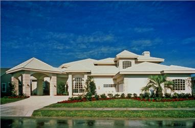 Front elevation photo of this luxury Mediterranean style home (ThePlanCollection: House Plan #190-1019)