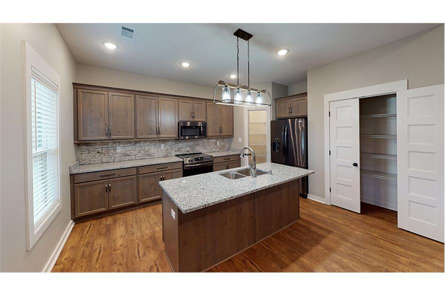 Kitchen: Kitchen Island of this 3-Bedroom,1640 Sq Ft Plan -193-1033