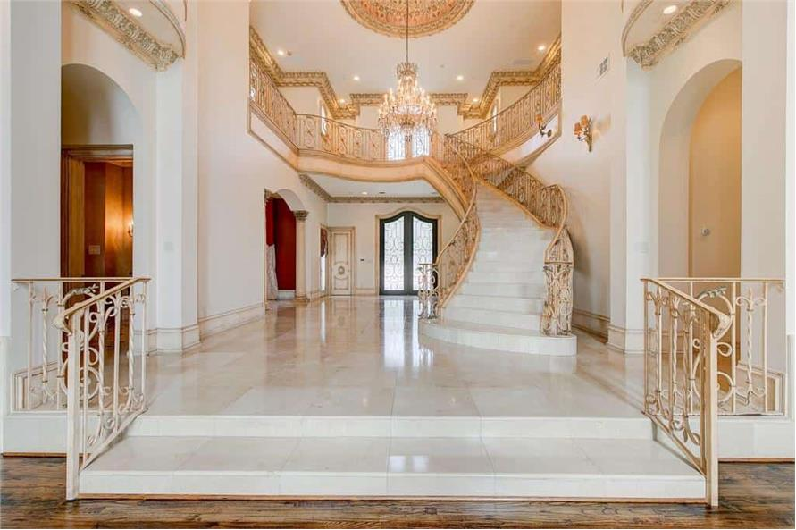 Entry Hall: Staircase of this 9-Bedroom,14727 Sq Ft Plan -195-1127