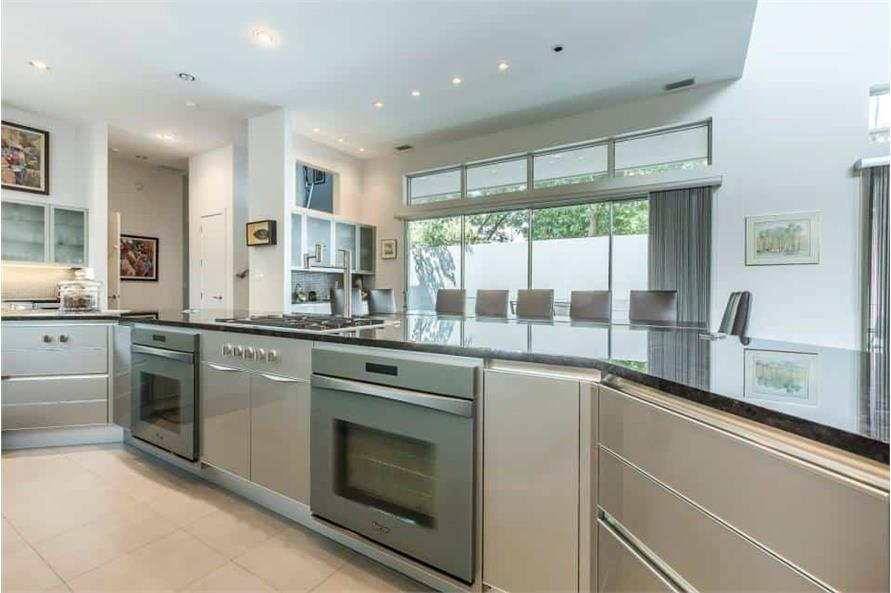 Kitchen: Breakfast Bar of this 3-Bedroom,4580 Sq Ft Plan -195-1249