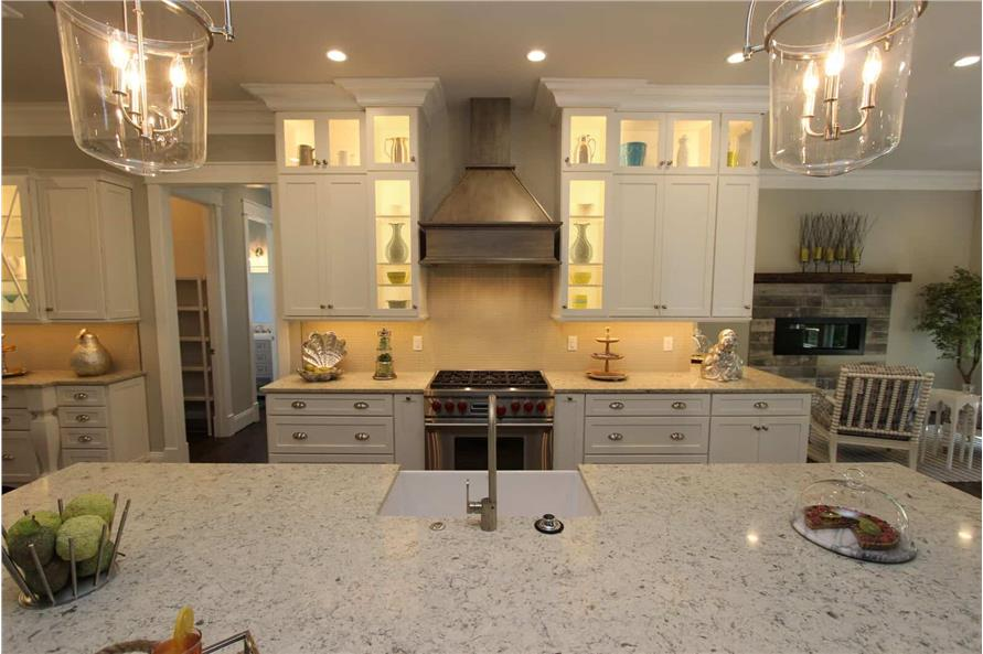 Kitchen: Kitchen Island of this 5-Bedroom,3970 Sq Ft Plan -198-1060