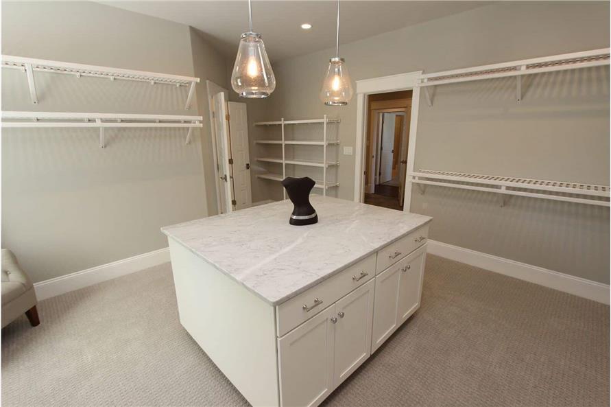 Master Bedroom: Closet of this 5-Bedroom,3970 Sq Ft Plan -198-1060