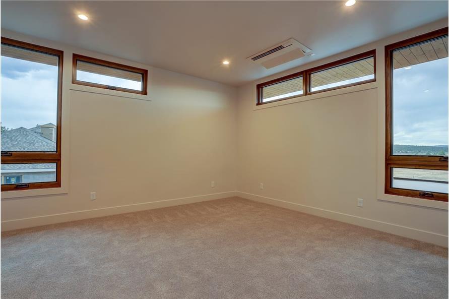 Bedroom of this 4-Bedroom,3837 Sq Ft Plan -202-1031