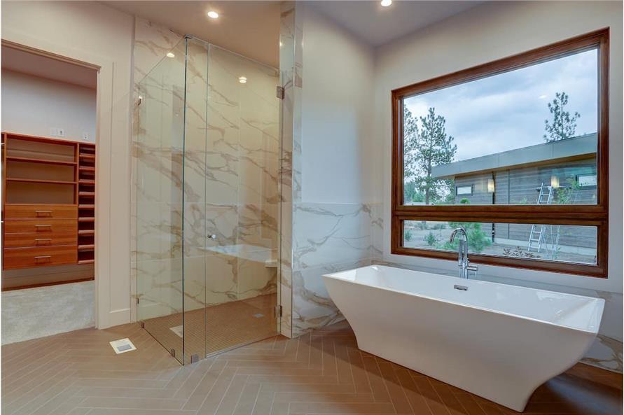 Master Bathroom: Tub of this 4-Bedroom,3837 Sq Ft Plan -202-1031