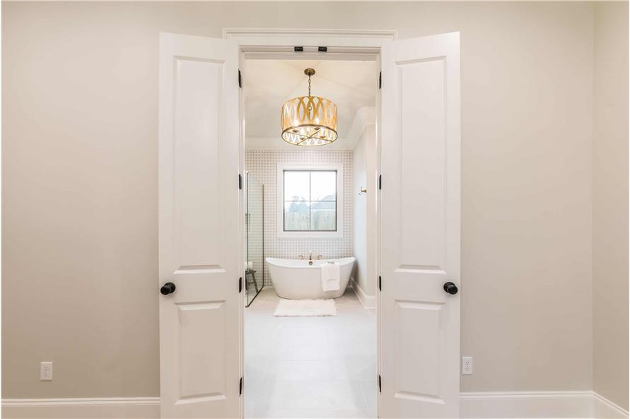 Master Bathroom: Tub of this 4-Bedroom,2300 Sq Ft Plan -204-1018