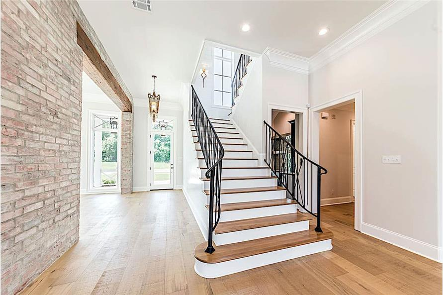 Entry Hall: Staircase of this 4-Bedroom,4443 Sq Ft Plan -204-1020