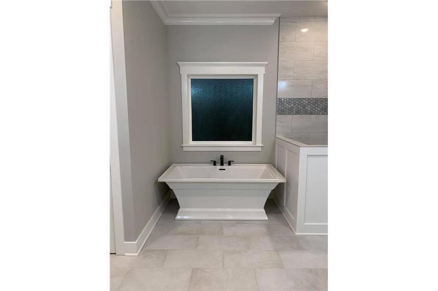 Master Bathroom: Tub of this 3-Bedroom,2535 Sq Ft Plan -206-1007