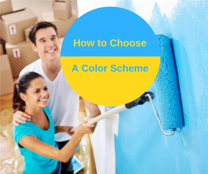 Homeowners painting a wall to illustrate article on choosing a color scheme