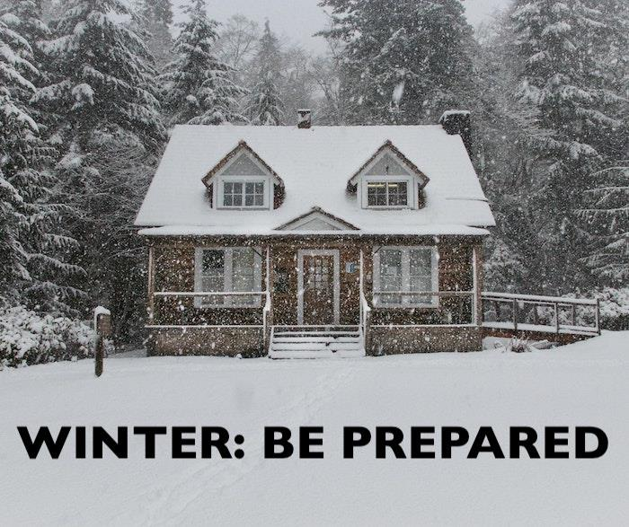 Cape Cod style home covered in snow illustrating article about winter preparedness