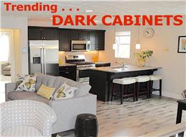 Kitchen with black kitchen cabinets illustrating article on trending dark cabinets in the kitchen