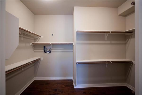 Large White Closet With Shelving And Hanging Rods In 3 Bedroom Craftsman  Style Home Design