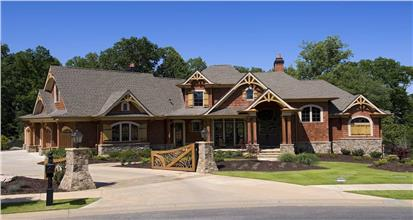 6-bedroom in the Luxury Cottage style with gable-end decorative accents, wood shake siding, and stone wainscoting