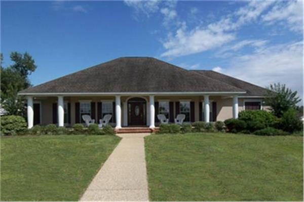 Ranch style home that features a Hip roof, 4 bedrooms, 3 baths and both a rear and front covered porch.