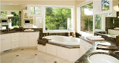 Sumptuous master bathroom with large windows and mirrors, soaking tub, and two vanities on opposite walls.