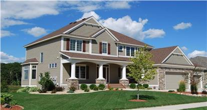 4-bedroom Country style Traditional home design with large white porch columns and stacked-stone accents.