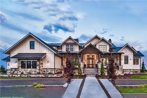 Exquisite 4955-sq.-ft. house design in the European style with cream-colored stucco siding and hip roof.