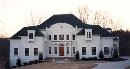 Imposing 2-story luxury home design in white with columns on the front porch, large windows, and a hip roof in black.