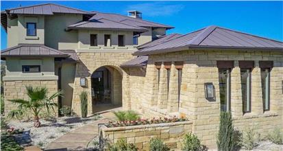 One story home designed in the Southwest style featuring 5 bedrooms and 3 baths.