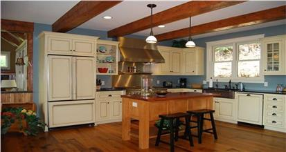 Home with country-styled eat-in kitchen including island and farmhouse sink.
