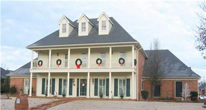 Southern style Colonial with 4 bedrooms, a 3 car garage and over 2900 square feet.