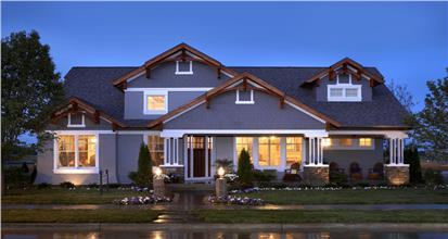 Evening view of blue 4083-sq.-ft. Craftsman home in white trim with 5 bedrooms, 3 full bathrooms, and 2 half baths.