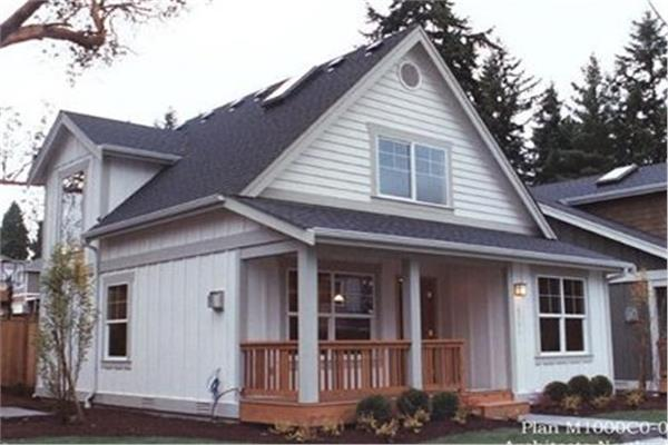 2-bedroom, 1000-sq.-ft. home in Bungalow style with front porch and beige siding.