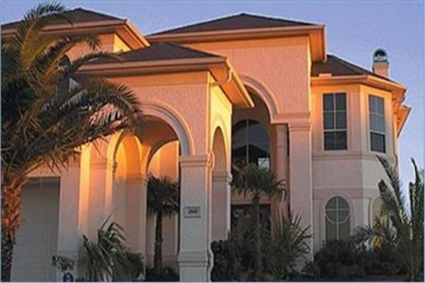 Closeup of 4-bedroom, 4354-sq.-ft. home in the Mediterranean style with stucco siding.