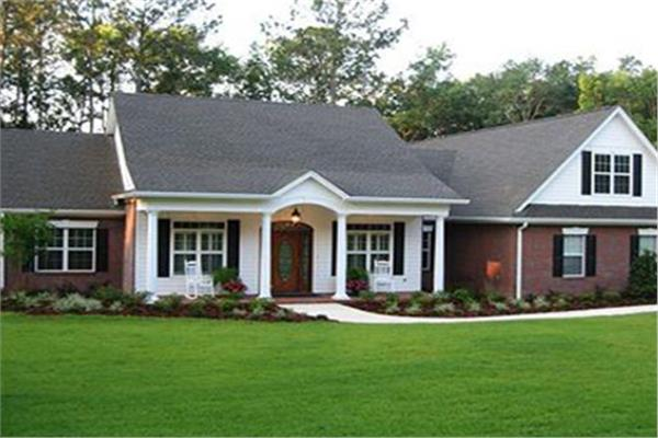 Attractive Ranch house plan with brick and white lap siding and front porch with columns.