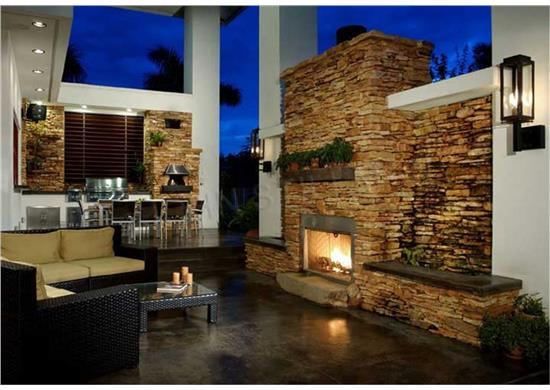 "Outdoor fireplace wall in ""outdoor room"" of Florida style home"