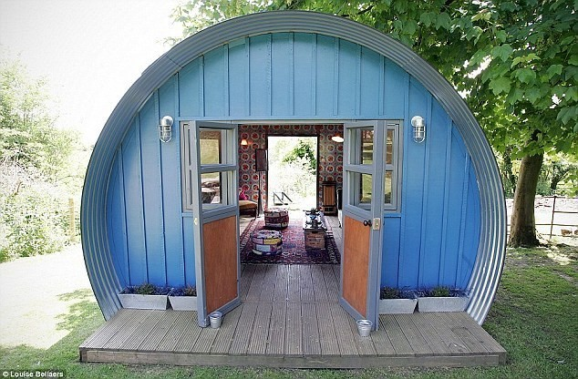 She shed painted in blue with gray trim