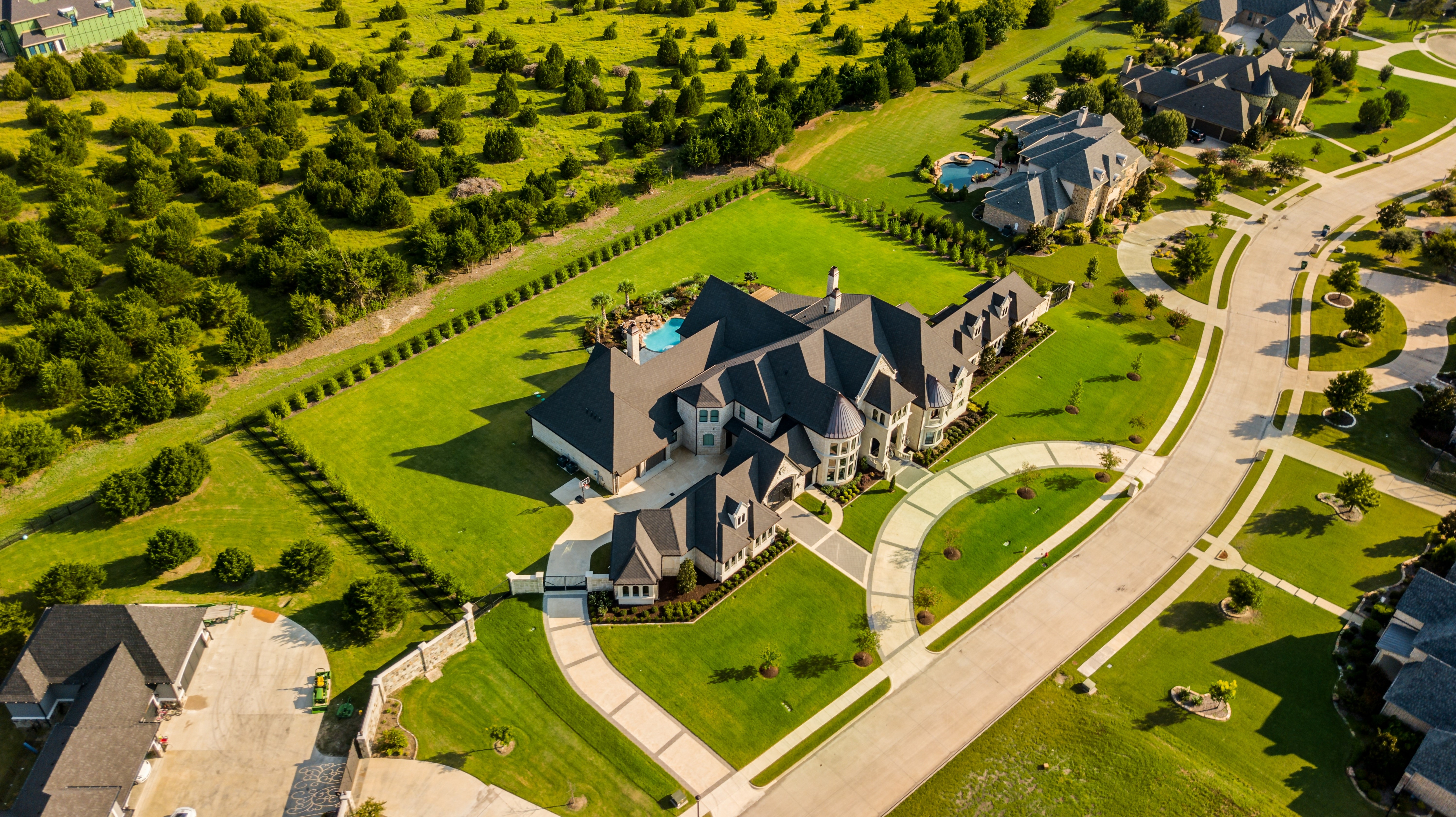 Aerial view of a large luxury European inspired home
