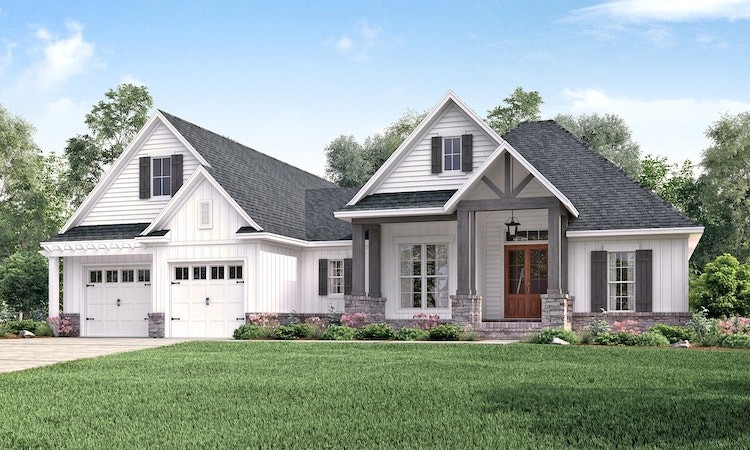White modern Farmhouse style home with variety of window styles
