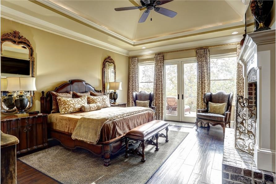 Comfortable master bedroom suite with fireplace and private balcony