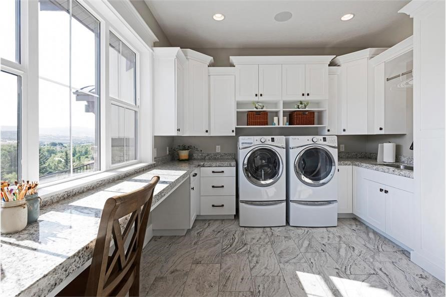 Large laundry room with room with office space along windows