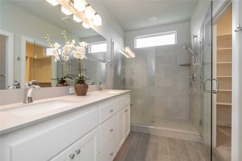 Bathroom with long double vanity and wall mirror to match