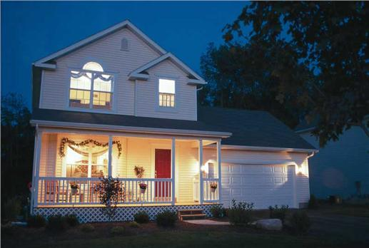 Lovely covered porch and courtyard make this 2-story, 3-bedroom country Bungalow house plan a home to pine for