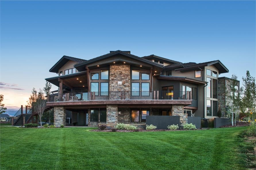 Luxury rustic home seen from the rear with large expanses of windows