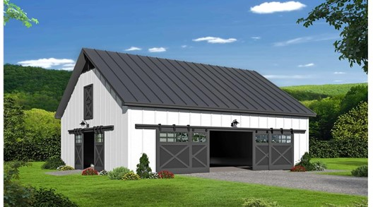 White barn with metal roof and wide sliding doors
