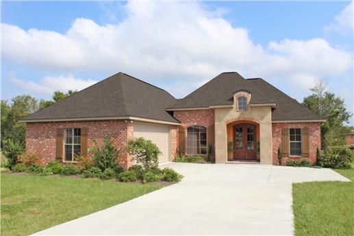 Acadian style brick home
