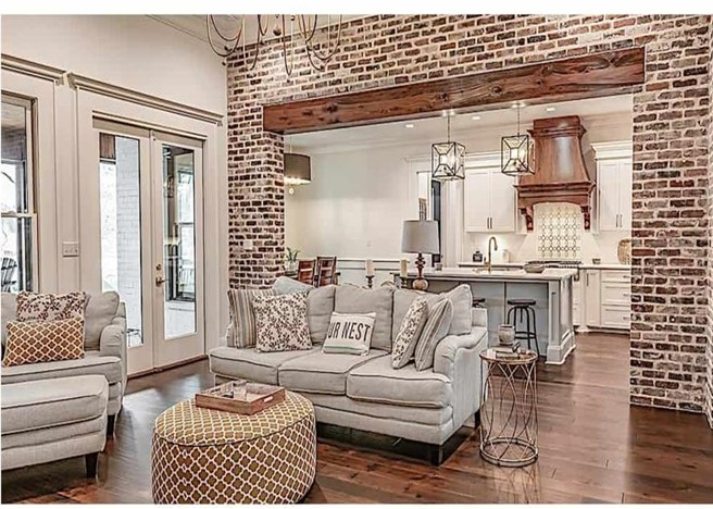 Common wall in brick between family room and kitchen in French Country style home