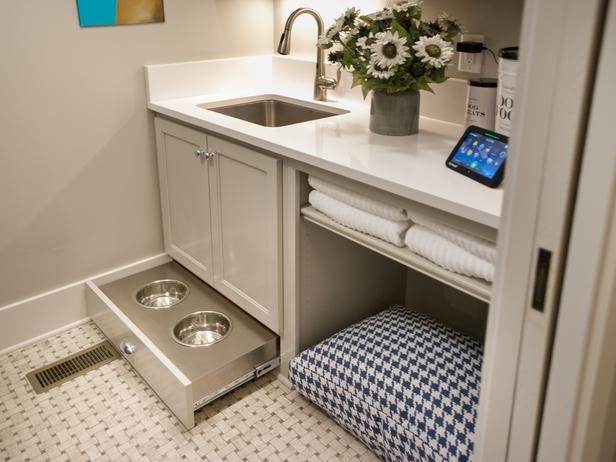 Built-in pet space in the powder room of a home