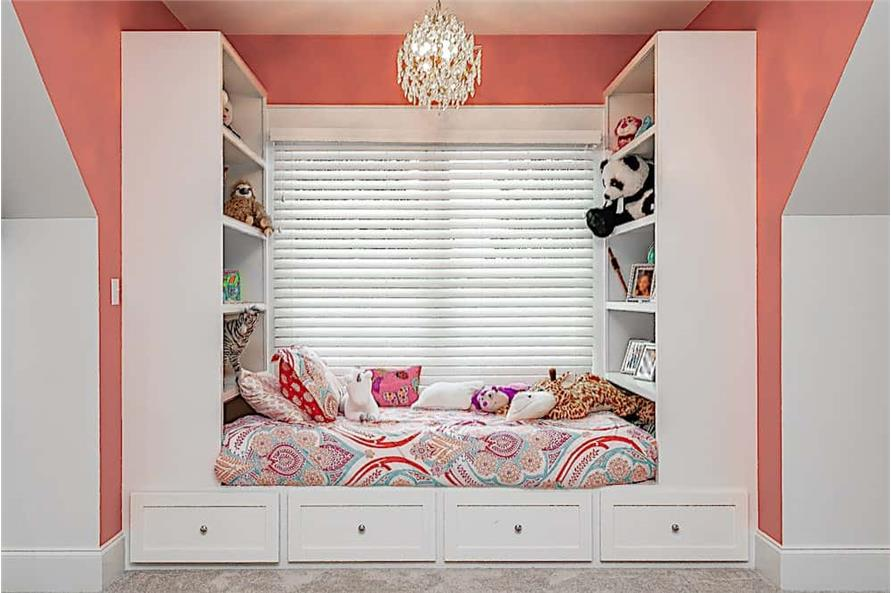 White built-in window seat with storage in a French Country style home