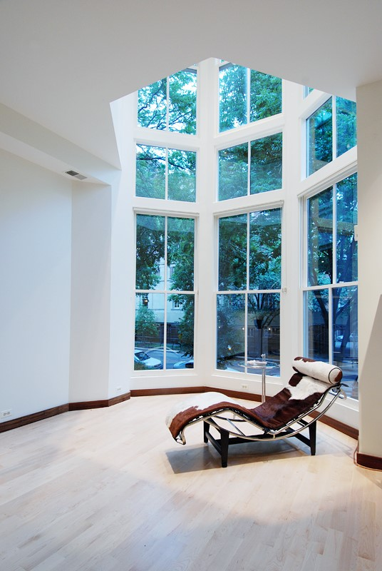Two-story-tall bay window in a modern home